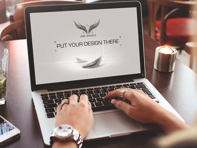 Working on MacBook Mockup Free PSD