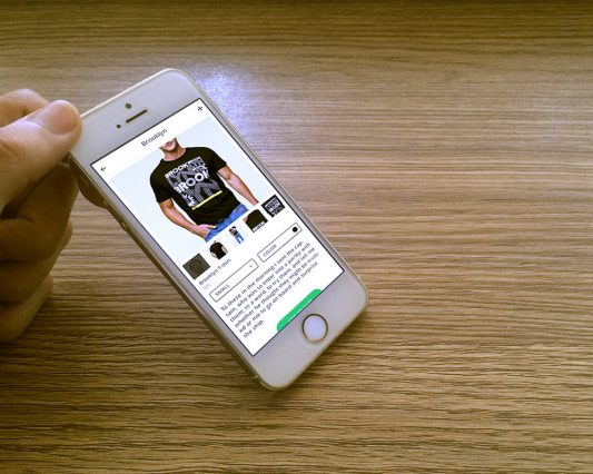 White iPhone 5s Photorealistic Mockup Free PSD