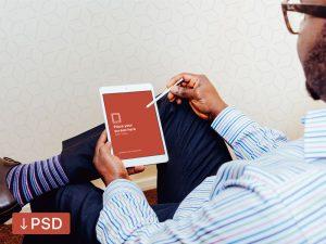 iPad Air in Hand Photorealistic mockup Free PSD