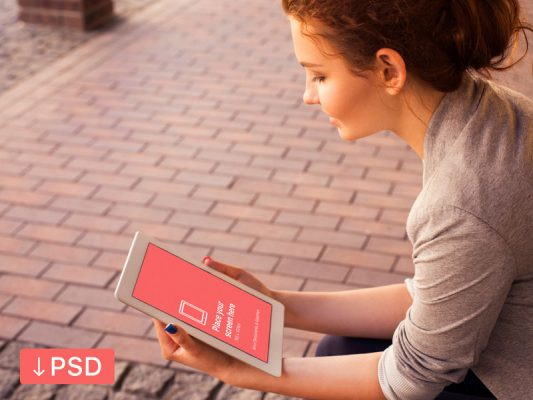 iPad in Hand Photorealistic Mockup Free PSD