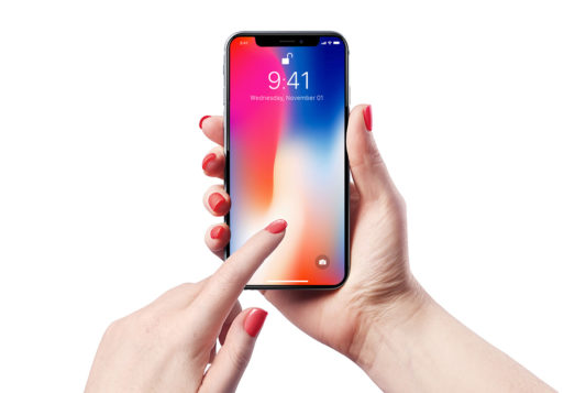 Female Holding iPhone X Mockup PSD