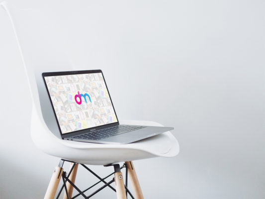 Macbook on Chair Mockup PSD