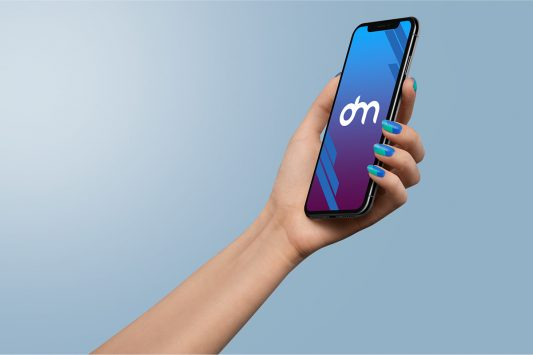 Woman Holding iPhone Xs in Hand Mockup