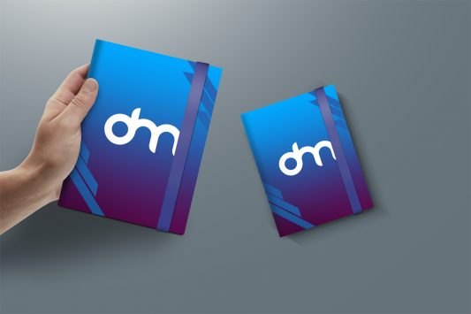 Hand Holding A4 Notebook Mockup